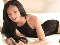 TS Nala lies on bed in sexy black lingerie and rubs her dick.
