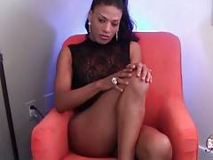 Amazing chocolate t-girl is sensually posing for your joy.