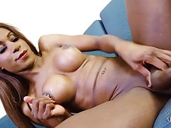 Krissy Toy is back and sexy in red! This hot black tgirl has a sexy slim body, perky big boobs, a firm ass and a sexy uncut cock! Enjoy this hot transgirl shaking her firm bubble butt!