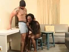 Attractive black tranny hungrily slurps partner`s boner.
