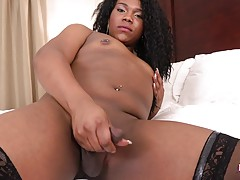 Rocking a colorful dress, yellow heels, and stockings again. Wanda shows off that big ass-pussy, but that doesn`t keep her from getting rock hard and showing how turned on she is. She lets out a thick, white cumshot and then shows off her sexy legs before